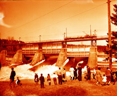 People admiring the falls when the Almaville spillway opens in spring